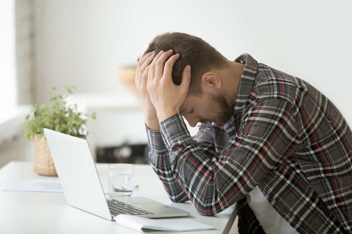 Frustrated depressed man shocked by online bankruptcy or stock downfall