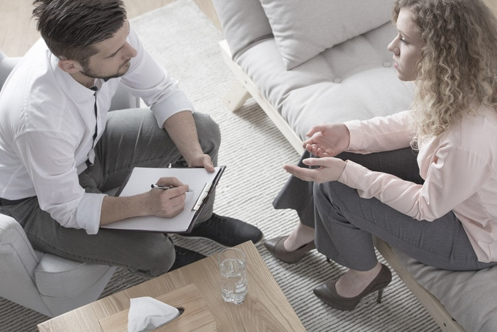 Woman consulting divorce with lawyer
