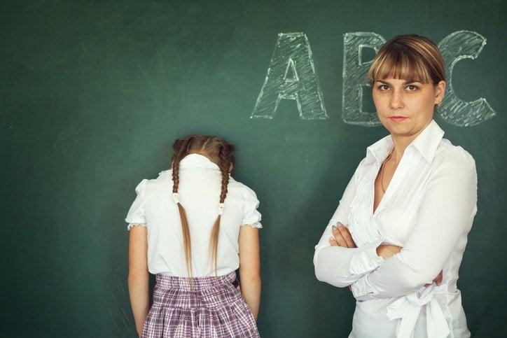 Female techer punishment her girl student over chalkboard.