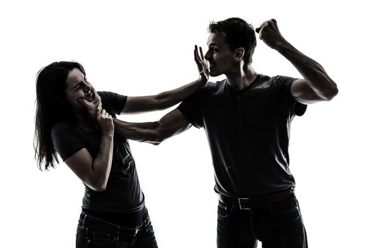 man beating up woman