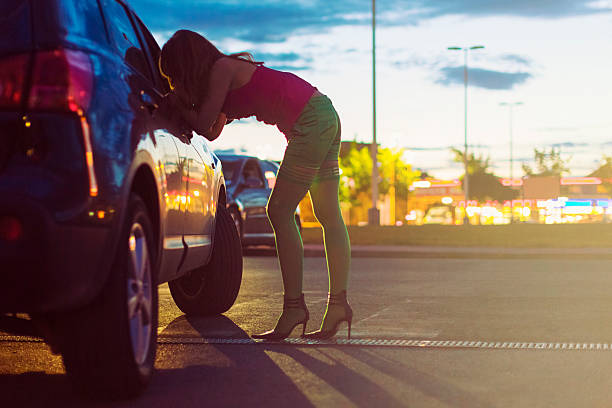 Prostitute at the car