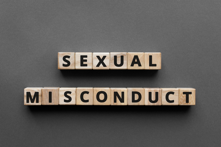 Sexual misconduct - words from wooden blocks with letters, sexual misconductconcept, top view gray background