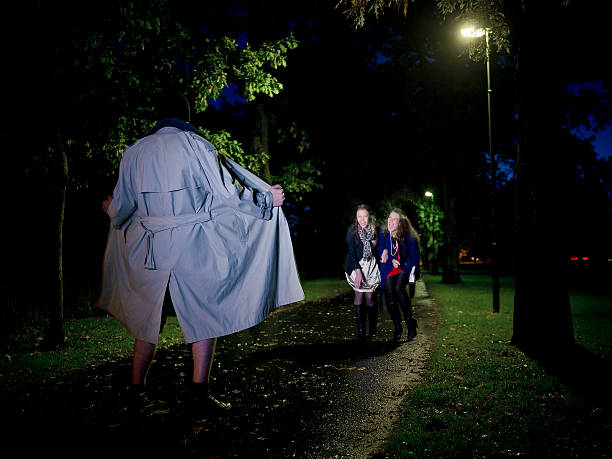 Two women laughing at a Flasher at night in the park sex offender