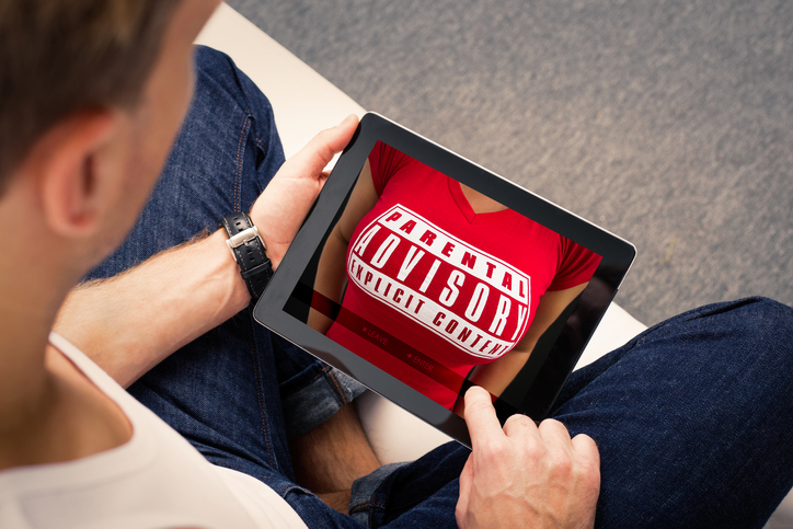 Man looking at adults website on tablet