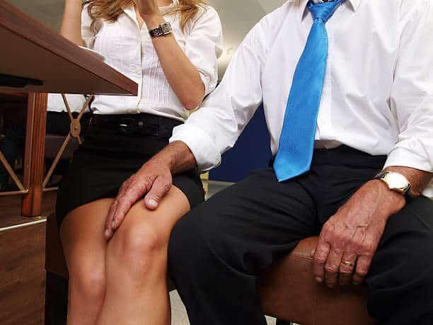 Man's hand on woman's knee.