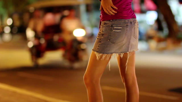 prostitute waiting for costumer on street at night